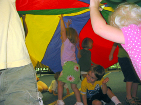 preschoolers with parachute